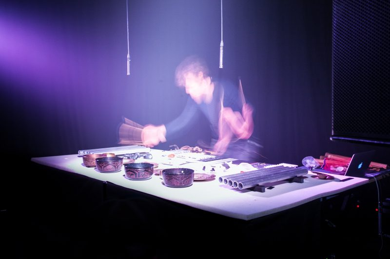 Melbourne musician Matthias Schack Arnott conducting a percussive performance
