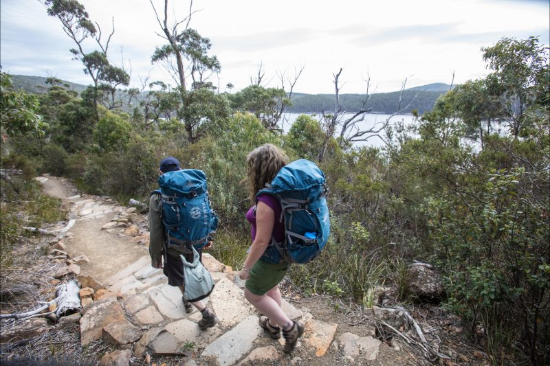 Walkers enjoy spectacular views of Fortescue Bay as they finish the Three Capes Track.