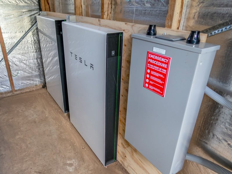 Two Tesla batteries and UPS in a shed at Tin Dragon Cottages, Tasmania