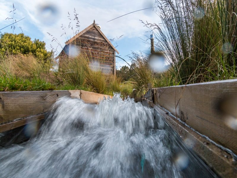 Water gushing through the micro-hydro tail race at Tin Dragon Cottages in Tasmania