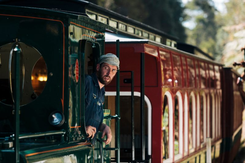 An engineer in charge of a locomotive on the West Coast Wilderness Railway