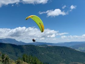 Tandem Paraglide over Mystic Mountain