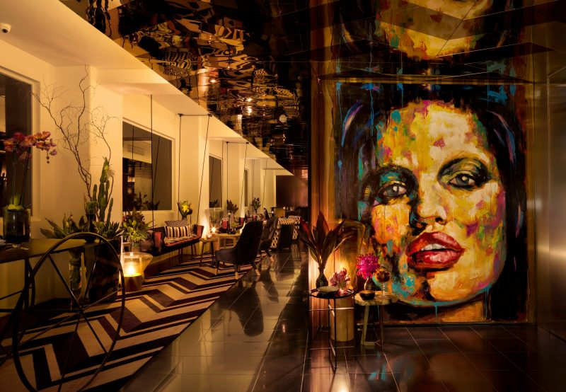 """Adelphi Hotel inside reception area with art work of """"Lucy"""""""