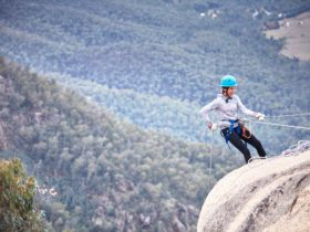 Abseiling off Echo Point Lookout on Mount Buffalo