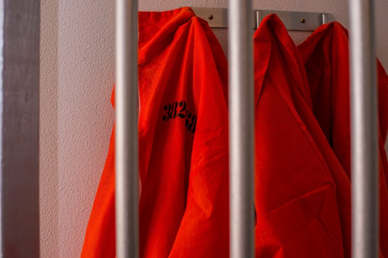 Adventure Rooms Escape Room Photo of Gaol Break inmates jumpsuit behind bars