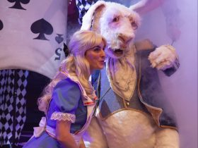 The character of Alice next to the White Rabbit