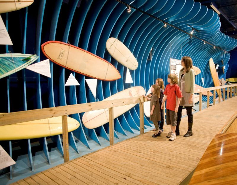 Checking out vintage surfboards along the boardwalk