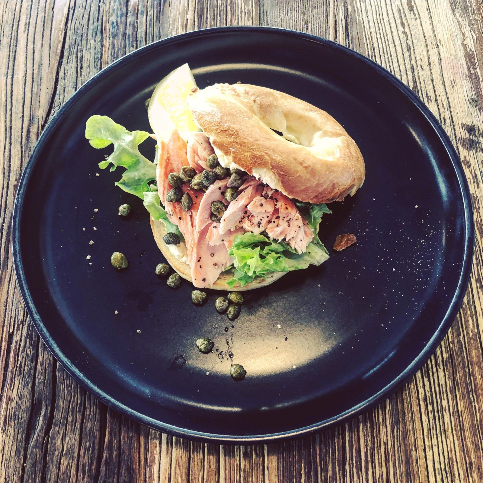Smoked salmon bagel with cream cheese and capers
