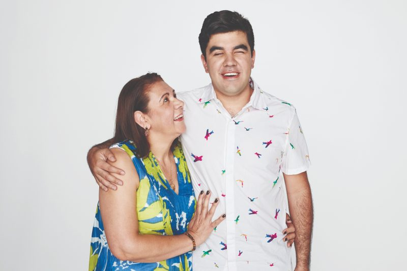 A male Vision Australia client aged in his 20's with his mother.