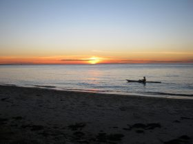 Sunset at the front beach at calm Bay