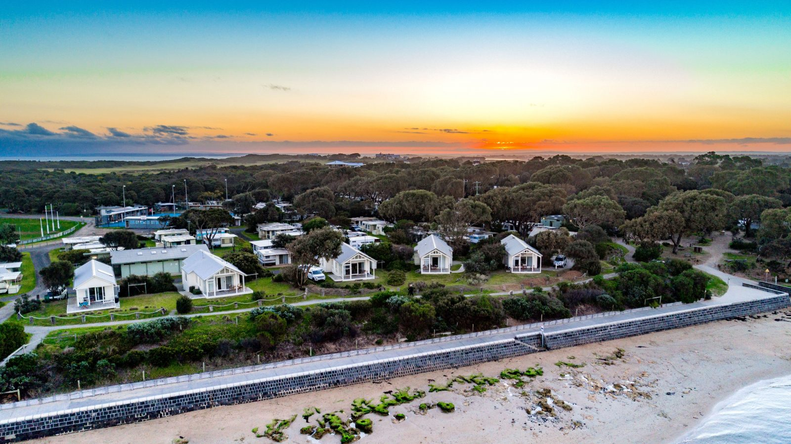 Sunset over our waterfront beach houses at the Barwon Heads Caravan Park