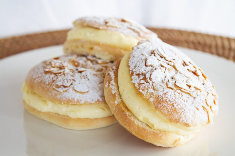 Beestings - melt-in-your-mouth buns filled with velvety custard and topped with toffeed almonds