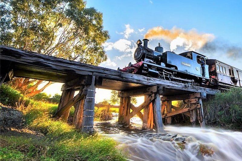 Steam locomotive on trestle bridge