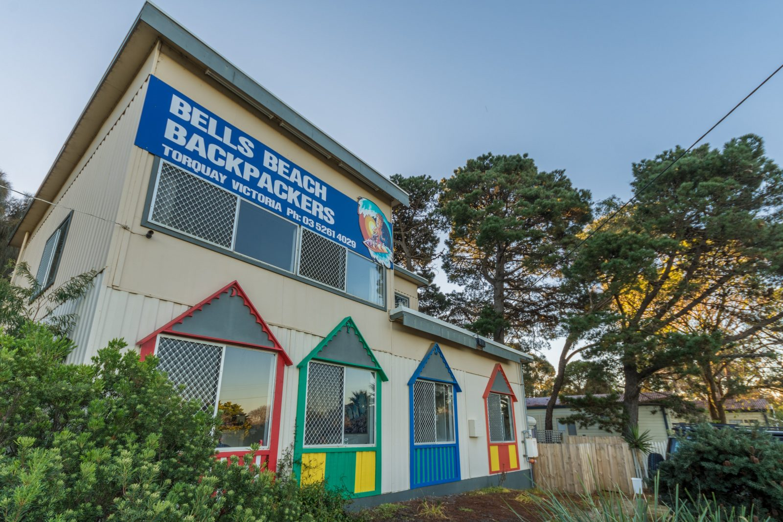 The coloured frames depict the Bathing boxes that were once located on Torquay Front Beach.