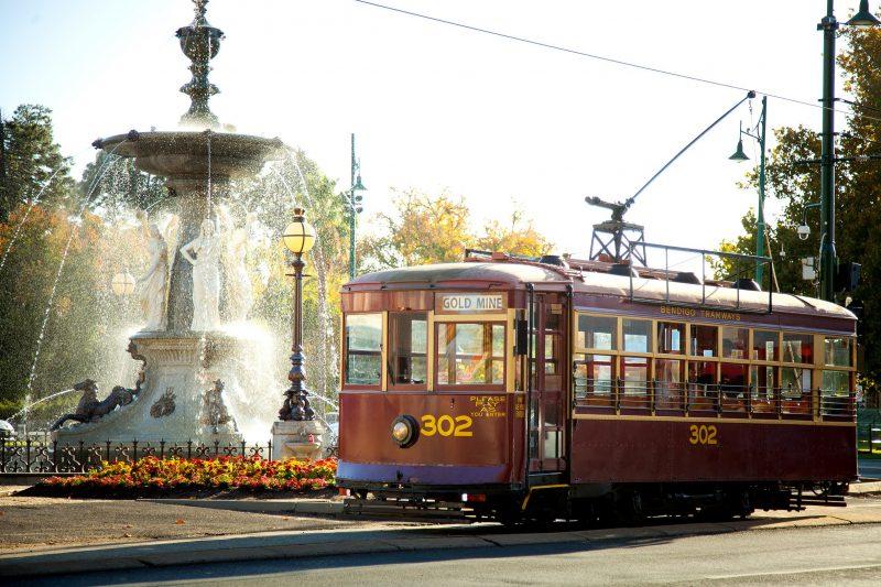 Vintage Talking Tram passing Alexandra Fountain