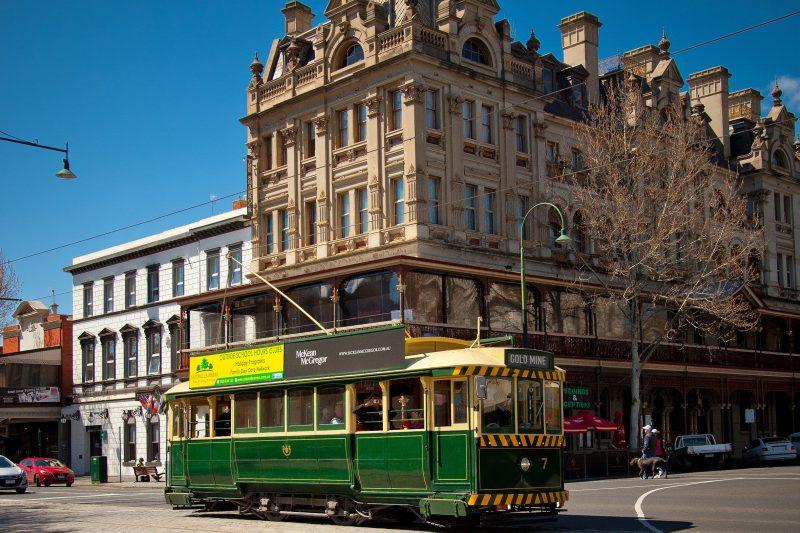 Vintage Talking Tram passing the Shamrock Hotel