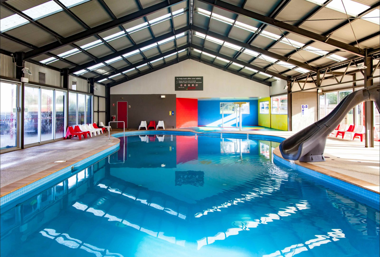 Heated swimming pool with slide