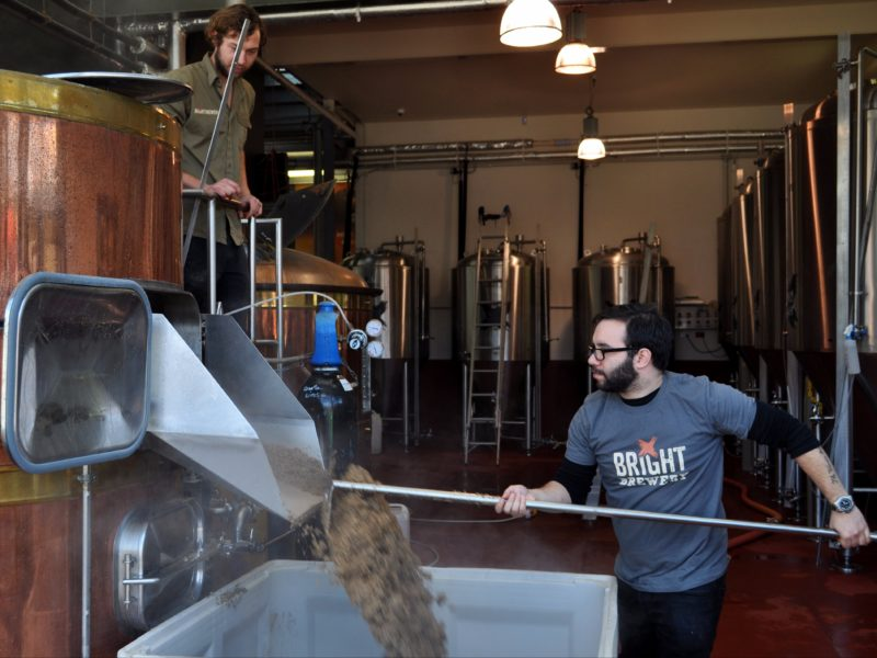 Clearing out the spent grain from the brew