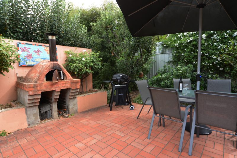 BBQ area with Pizza Oven and outdoor furniture