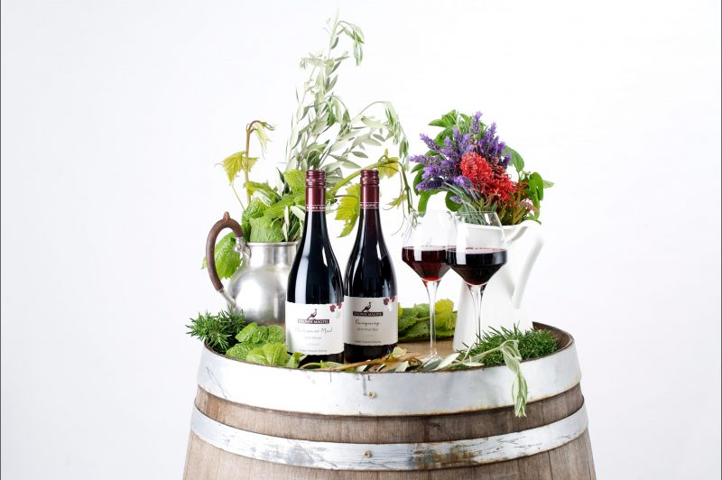 Reserve wines and glass on barrels