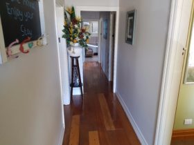 Wooden floorboards throughout the house