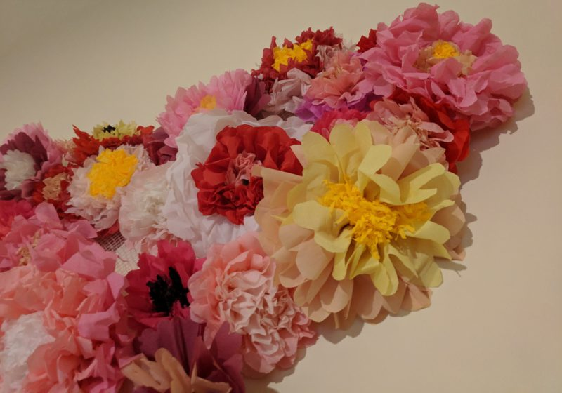 Paper flower display. Flowers are made from crepe paper in natural colours- pink, red, yellow, brown
