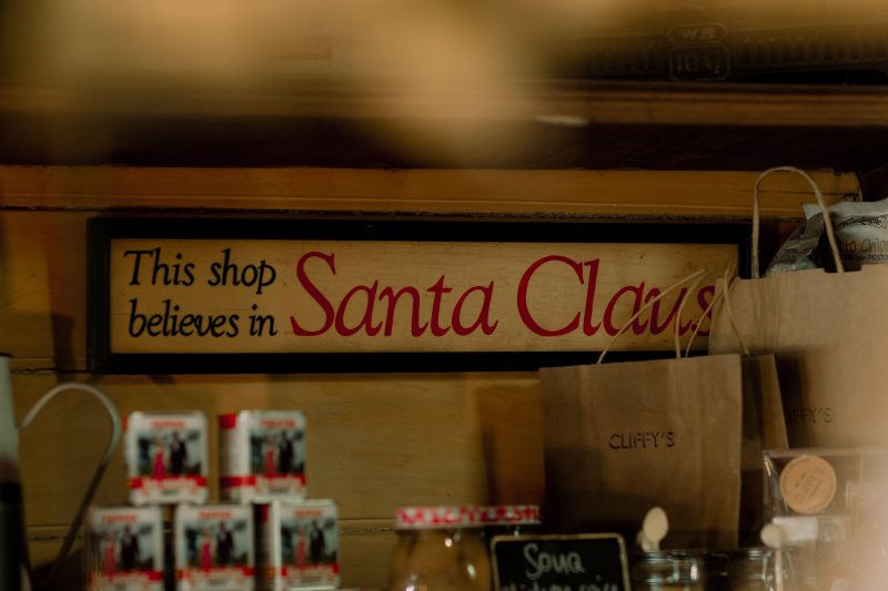 A sign hanging inside Cliffy's which reads 'this shop believes in Santa Clause'