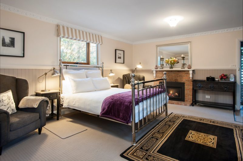 Camellia Cottage - A Romantic Haven - Lounge/bedroom with comfy chairs, gas fire & queen size bed