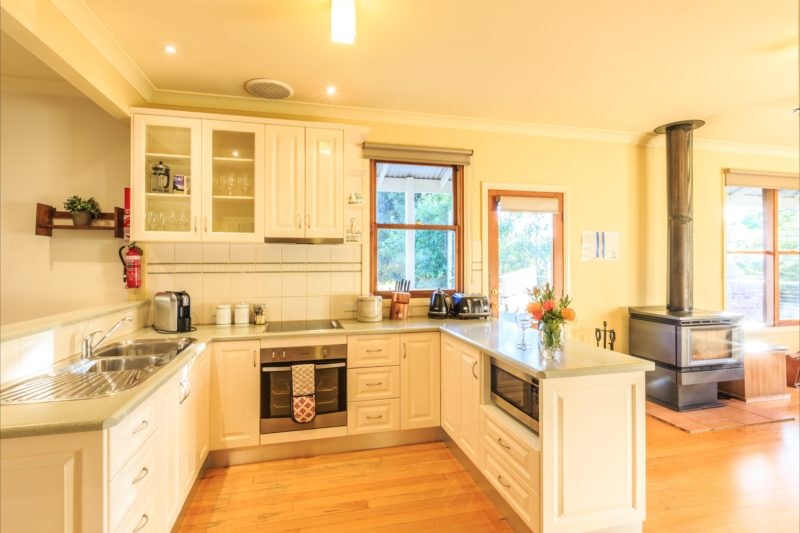Modern fully equipped kitchen to cook up a storm and wood heater for cozy evenings
