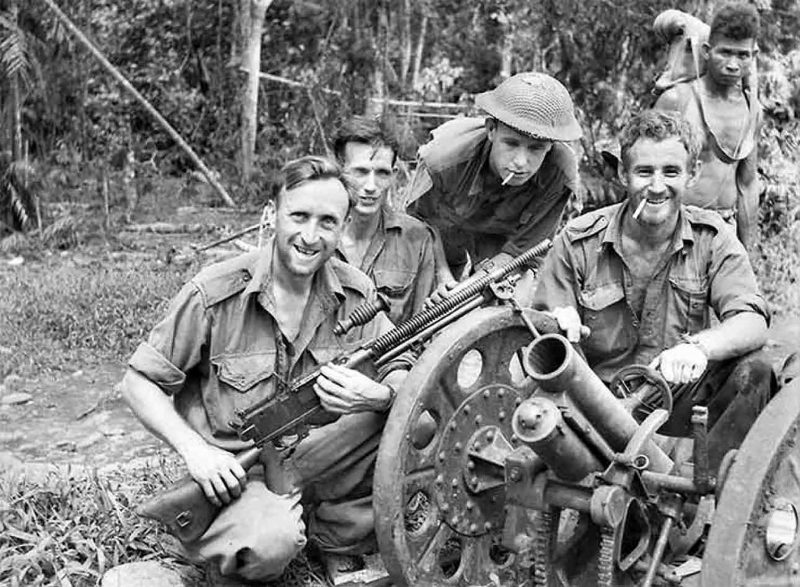 Australian troops with captured Japanese field gun on Kakoda Track