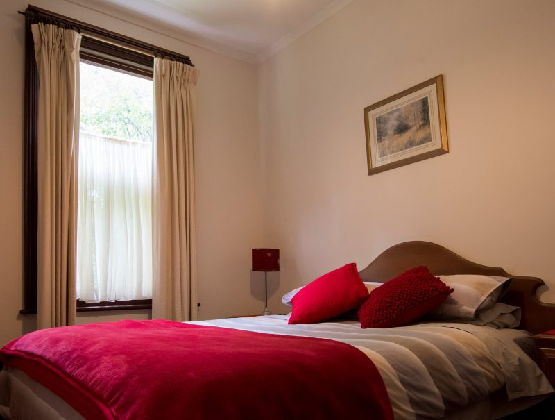 Main bedroom containing one queen size bed.