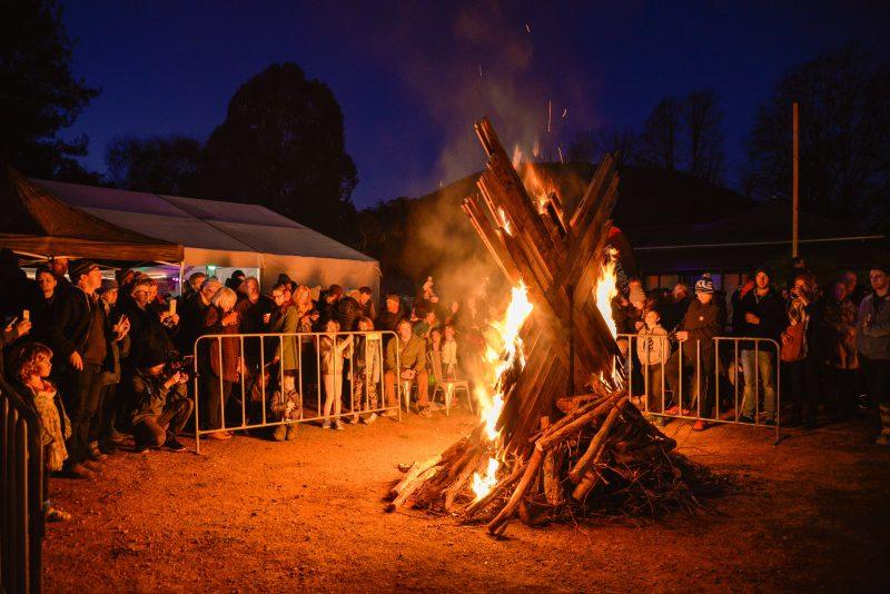 A large wooden structure bonfire