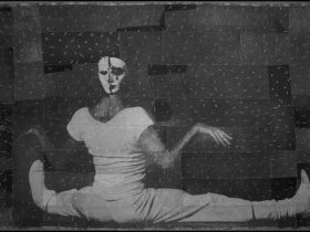 Monochrome collage image of seated figure with mask