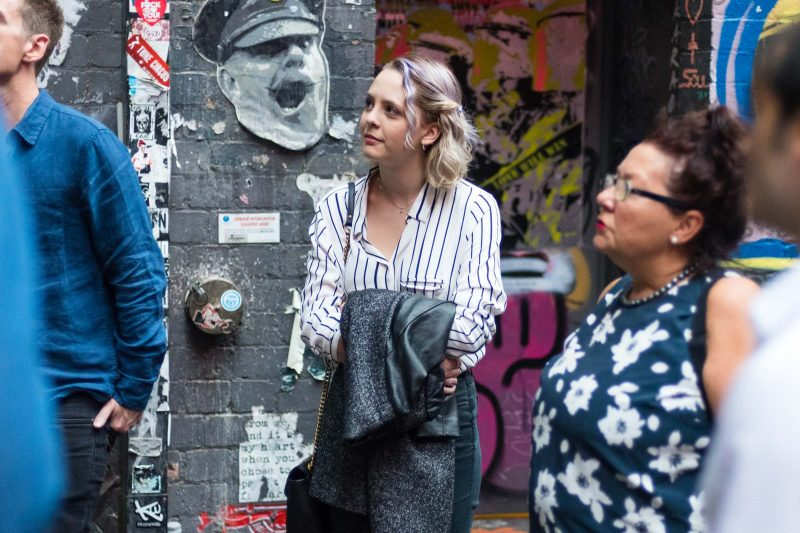 The group looks at some street art in one of Melbourne's lane ways.