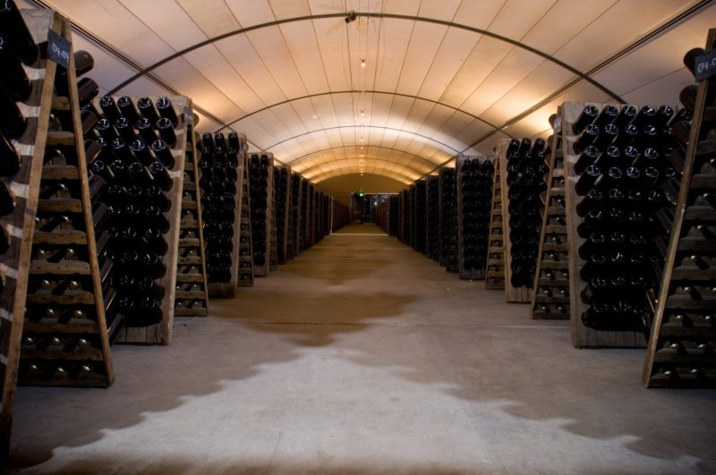 The arched ceiling in the 72,000 bottle riddling hall is a reminder of the caverns in Champagne.