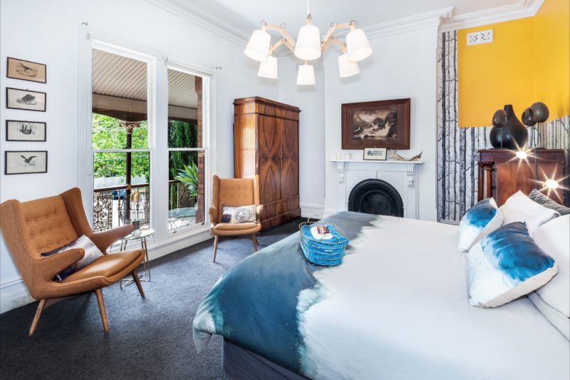 Lascelles no. eight grand master bedroom with kings sized bed and private balcony