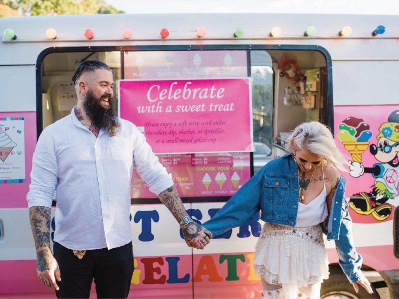 Couplein front of ice cream truck
