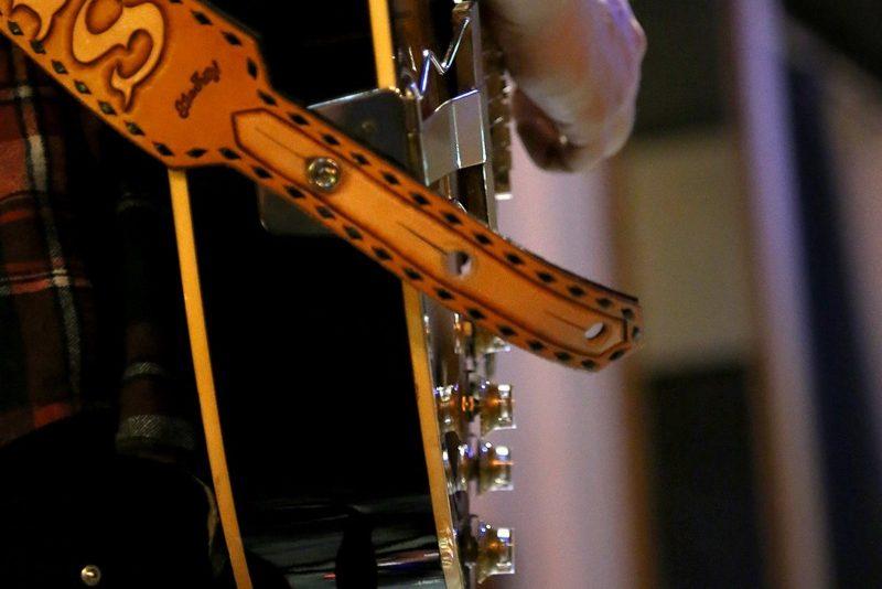 Artist performing, guitar close up