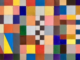 Wide painting made up of coloured squares with hidden word Frock