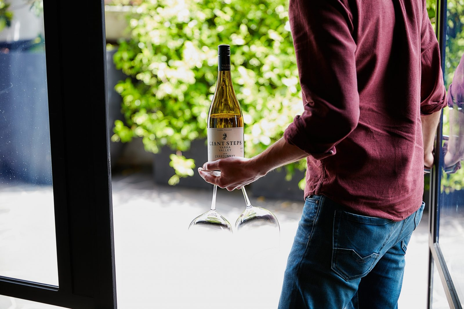 A Giant Steps Chardonnay being tasted in the courtyard.