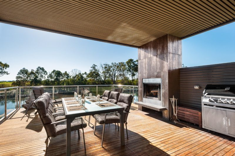 Deck with dining setting, barbecue and open fireplace