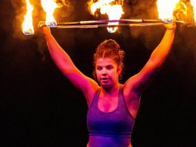 Circus performer working with flaming hoop