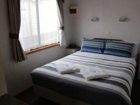 Main bedroom in Deluxe Villa Cabins
