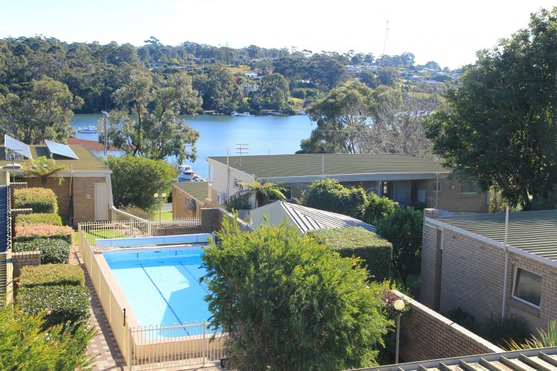 View from the top end of the property overlooking the complex swimming pool with lake below