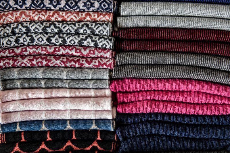 Designed and knitted on-site we have a large range of scarves