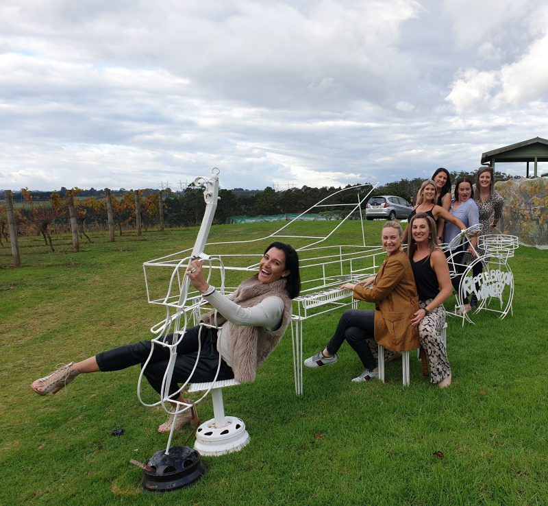 Ladies ob the musical instrument sculpture at Ripplebrook Winery