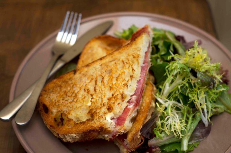 Le Peche Gourmand - Toasted prosciutto and gruyere cheese sandwich