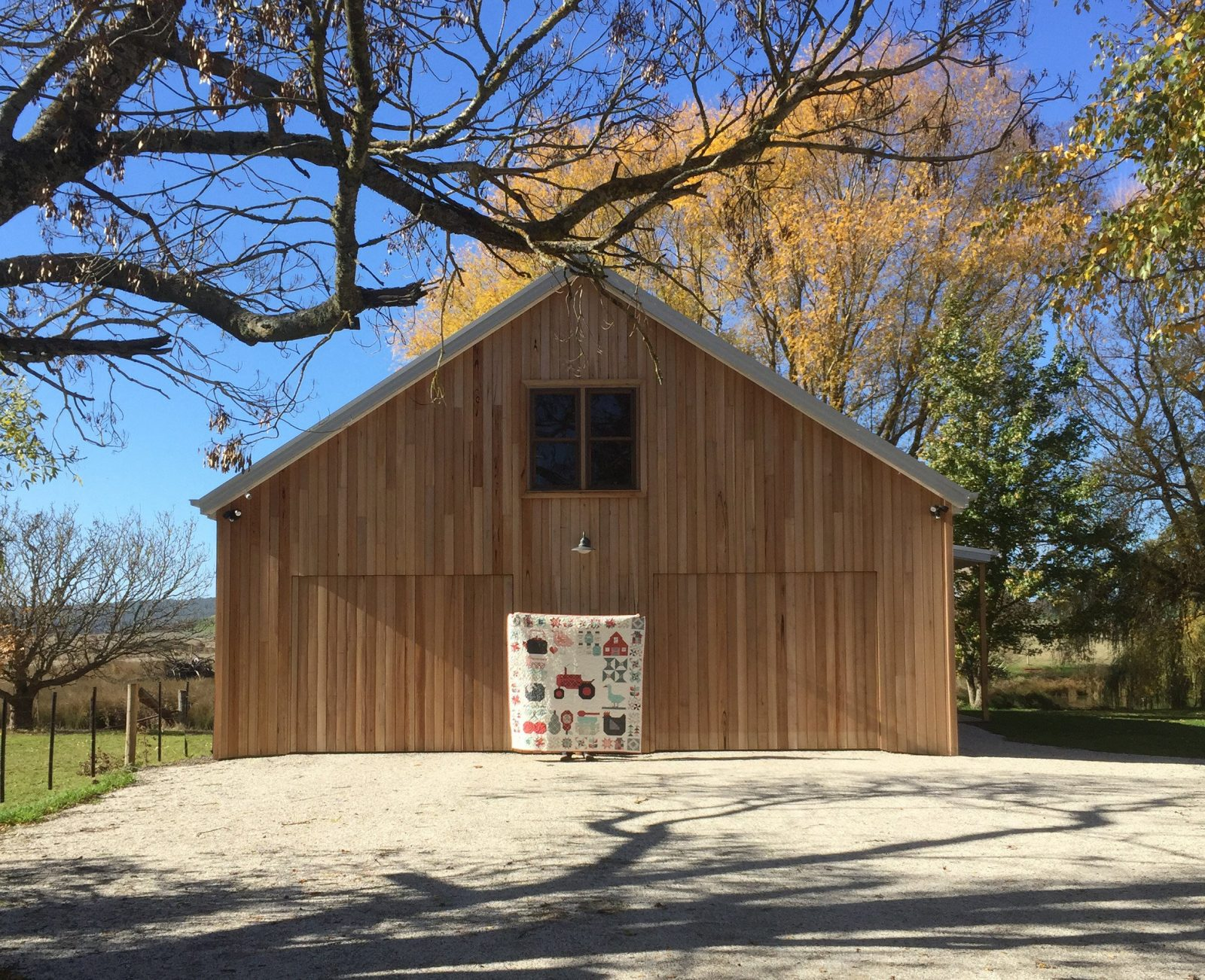Said With Love Quilt Barn with quilt in front and rural setting