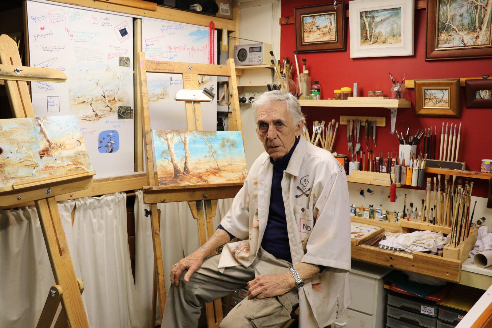 Mal is seated in his Inglewood art studio