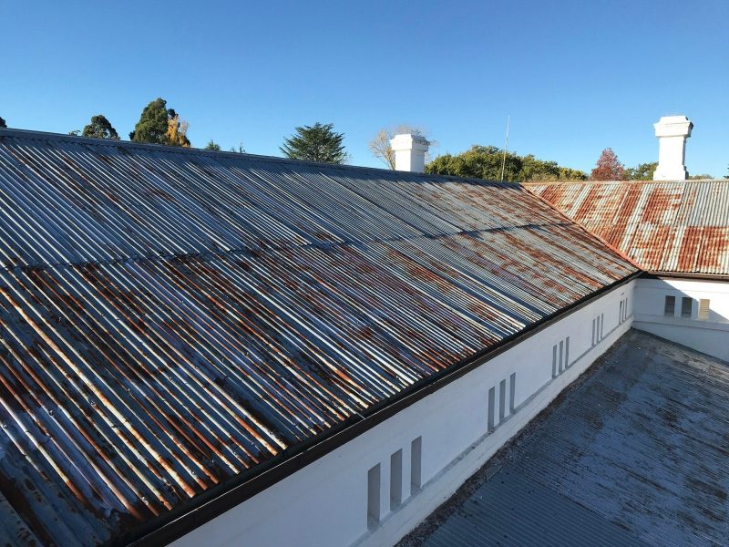 Colour photo of the store galvanized steel roof-line showing some surface rust